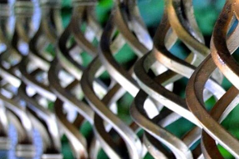Fence Repairs - Fence Repairs - decorative helical metal parts of fence