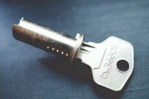 Locksmith cost - silver key on blue background