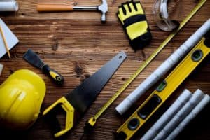 Tools and Hard-hat on Wooden Floor