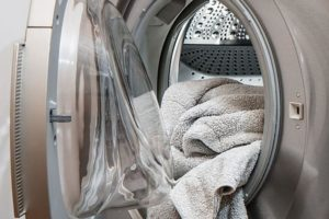 Washing Machine with towel falling out of opening