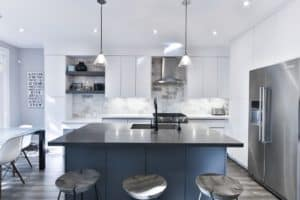 Modern Kitchen with black countertop and hanging lamps